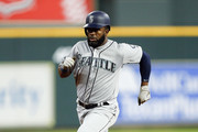 Denard Span #4 of the Seattle Mariners triples in the first inning against the Houston Astros at Minute Maid Park on August 9, 2018 in Houston, Texas.