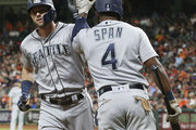 Mitch Haniger #17 of the Seattle Mariners receives a high five from Denard Span #4 after hitting a home run in the first inning against the Houston Astros at Minute Maid Park on August 9, 2018 in Houston, Texas.