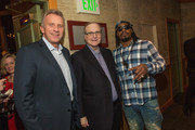 (L-R) Joe Montana, Paul Allen and Marshawn Lynch attend the FAM 1st FAMILY FOUNDATION Charity Event at The Edgewater Hotel on December 14, 2014 in Seattle, Washington.