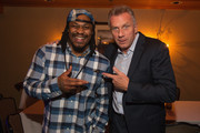 Marshawn Lynch (L) and Joe Montana attend the FAM 1st FAMILY FOUNDATION Charity Event at The Edgewater Hotel on December 14, 2014 in Seattle, Washington.