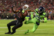 Wide receiver Larry Fitzgerald #11 of the Arizona Cardinals is unable to complete the pass against cornerback Richard Sherman #25 of the Seattle Seahawks in the first half of the NFL game at University of Phoenix Stadium on November 9, 2017 in Glendale, Arizona.