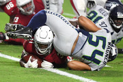 Running back David Johnson #31 of the Arizona Cardinals scores a touchdown against linebacker Bobby Wagner #54 of the Seattle Seahawks during the second quarter at State Farm Stadium on September 30, 2018 in Glendale, Arizona.