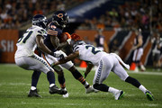 Earl Thomas #29 of the Seattle Seahawks attempts to tackle Josh Bellamy #15 of the Chicago Bears in the fourth quarter at Soldier Field on September 17, 2018 in Chicago, Illinois.