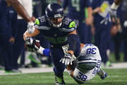 Jimmy Graham #88 of the Seattle Seahawks is tackled by Jeff Heath #38 of the Dallas Cowboys at AT&T Stadium on November 1, 2015 in Arlington, Texas.