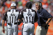 Head coach Pete Carroll of the Seattle Seahawks questions a call with side judge James Coleman and referee Walt Anderson against the Denver Broncos at INVESCO Field at Mile High on September 19, 2010 in Denver, Colorado. The Broncos defeated the Seahawks 31-14.