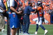 Head coach Vance Joseph talks with Adam Jones #24 of the Denver Broncos during a game against the Seattle Seahawks at Broncos Stadium at Mile High on September 9, 2018 in {Denver, Colorado.