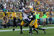Kentrell Brice #29 of the Green Bay Packers defends Jimmy Graham #88 of the Seattle Seahawks during the second half at Lambeau Field on September 10, 2017 in Green Bay, Wisconsin.