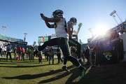 Jimmy Graham #88 and Doug Baldwin #89 of the Seattle Seahawks enter the field prior to the start of their game against the Jacksonville Jaguars at EverBank Field on December 10, 2017 in Jacksonville, Florida.