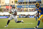 Running back Mike Davis #27 of the Seattle Seahawks runs for a touchdown on a pass reception in the fourth quarter against the Los Angeles Rams at Los Angeles Memorial Coliseum on November 11, 2018 in Los Angeles, California.