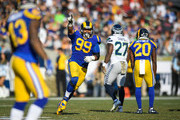 Defensive end Aaron Donald #99 of the Los Angeles Rams celebrates a sack in the second quarter against the Seattle Seahawks at Los Angeles Memorial Coliseum on November 11, 2018 in Los Angeles, California.