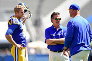 Jared Goff #16 of the Los Angeles Rams and head coach Jeff Fisher  before the game between the Los Angeles Rams and the Seattle Seahawks at Los Angeles Coliseum on September 18, 2016 in Los Angeles, California.