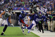 DeAndre Elliott #21 of the Seattle Seahawks is knocked out-of-bounds by Janoris Jenkins #20 of the New York Giants during the second quarter of the game at MetLife Stadium on October 22, 2017 in East Rutherford, New Jersey.