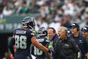 Head coach Pete Carroll of the Seattle Seahawks reacts with Jimmy Graham #88 in the third quarter against the New York Jets at MetLife Stadium on October 2, 2016 in East Rutherford, New Jersey.
