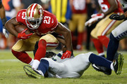 Reggie Bush #23 of the San Francisco 49ers is tackled by Kam Chancellor #31 of the Seattle Seahawks during their NFL game at Levi's Stadium on October 22, 2015 in Santa Clara, California.