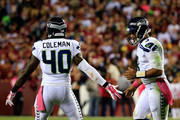 Russell Wilson #3 celebrates after scoring in the second quarter with teammate  Derrick Coleman #40 of the Seattle Seahawks against the Washington Redskins at FedExField on October 6, 2014 in Landover, Maryland.