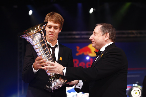 Sebastian Vettel In this handout image provided by FIA (Federation Internationale de l'Automobile), FIA President Jean Todt presents Formula One World Champion Sebastian Vettel with the Drivers' trophy during the 2010 FIA Gala Prize Giving Ceremony on December 10, 2010 in Monaco.