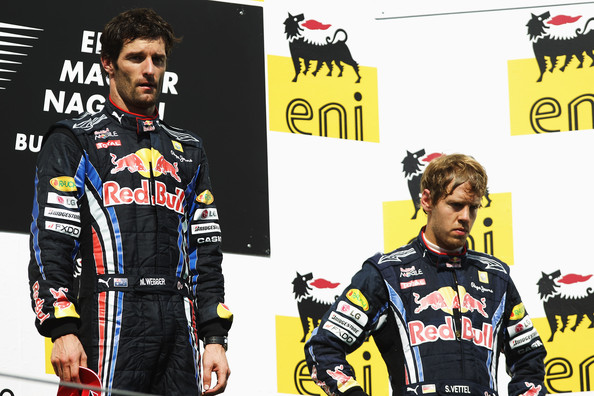 Sebastian Vettel (L-R) Race winner Mark Webber of Australia and Red Bull Racing and third placed Sebastian Vettel of Germany and Red Bull Racing are seen on the podium following the Hungarian Formula One Grand Prix at the Hungaroring on August 1, 2010 in Budapest, Hungary.