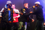 Formula One World Champion Sebastian Vettel of Red Bull Racing shakes hands with Xavier Naidoo of 'Soehne Mannheims' during his World Championship Party with 30,000 spectators in his home town on October 22, 2011 in Heppenheim, Germany.