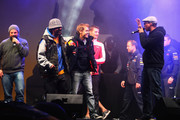 Formula One World Champion Sebastian Vettel of Red Bull Racing stands on the stage with 'Soehne Mannheims' during his World Championship Party with 30,000 spectators in his home town on October 22, 2011 in Heppenheim, Germany.