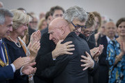 Brazilian photographer Sebastiao Salgado hugs Wim Wenders (R) after his speech during the Peace Prize of the German Book Trade award ceremony at St. Paul's Church (Paulskirche) on October 20, 2019 in Frankfurt am Main, Germany. The Board of Trustees issued the following statement with regard to their choice: 'In doing so, the association and its members have chosen to honour an exceptional visual artist who has continually campaigned on behalf of peace and social justice and whose entire photographic oeuvre lends a sense of urgency to the global debate surrounding nature conservation and environmental protection.'