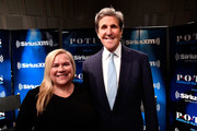 Former Secretary of State John Kerry talks with SiriusXM's Julie Mason (L) during a SiriusXM Town Hall event on October 2, 2018 in Washington, DC.