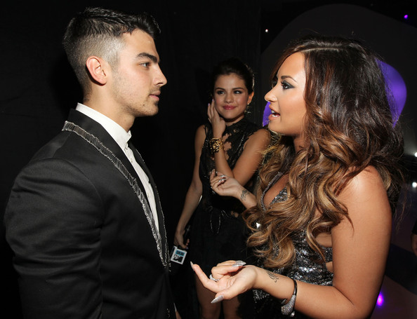 Selena Gomez Singer Joe Jonas, actress Selena Gomez, and singer Demi Lovato arrive at the 2011 MTV Video Music Awards at Nokia Theatre L.A. LIVE on August 28, 2011 in Los Angeles, California.
