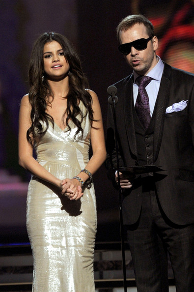 Selena Gomez Singers Selena Gomez and Donnie Wahlberg speak onstage during The 53rd Annual GRAMMY Awards held at Staples Center on February 13, 2011 in Los Angeles, California.