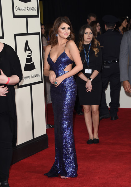 The 58th GRAMMY Awards - Arrivals [red carpet,carpet,dress,clothing,gown,premiere,flooring,event,shoulder,fashion,arrivals,selena gomez,grammy awards,staples center,los angeles,california,the 58th grammy awards]
