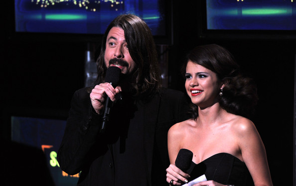 Selena Gomez Musician Dave Navarro (L) and actress Selena Gomez speak onstage during the GRAMMY Nominations Concert Live at Club Nokia on December 1, 2010 in Los Angeles, California.
