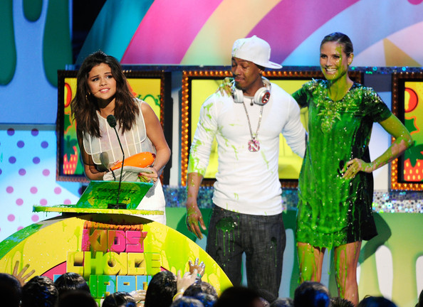 Selena Gomez Singer/Actress Selena Gomez, actor Nick Cannon and model Heidi Klum stand onstage during Nickelodeon's 24th Annual Kids' Choice Awards at Galen Center on April 2, 2011 in Los Angeles, California.