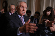 Senate Minority Leader Harry Reid (D-NV) talks to reporters following the weekly Senate Democratic policy luncheon at the U.S. Capitol September 13, 2016 in Washington, DC. Reid repeated his call on the Senate Republicans in the majority to allow a vote for funding to fight against the Zika virus and to pass a federal budget continuing resolution.