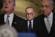 Sen. Charles Schumer (D-NY) (C) joins Senate Minority Whip Richard Durbin (D-IL) (L) and Senate Majority Leader Harry Reid (D-NV) following the weekly Senate Democratic policy luncheon at the U.S. Capitol November 17, 2015 in Washington, DC. Senate Democratic leaders said they will wait until after being briefed by the White House later this week before deciding how to proceed with allowing more refugees from Syria into the United States.