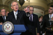 Senate Minority Leader Harry Reid (D-NV) (2nd L) talks to reporters with Senate Minority Whip Richard Durbin (D-IL) and Sen. Charles Schumer (D-NY) following the weekly Senate Democratic policy luncheon at the U.S. Capitol November 17, 2015 in Washington, DC. Senate Democratic leaders said they will wait until after being briefed by the White House later this week before deciding how to proceed with allowing more refugees from Syria into the United States.