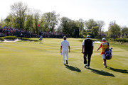Colin Montgomerie of Scotland walks up to the 18th green along with Bernhard Langer of Germany on his way to winning the 2014 Senior PGA Championship presented by KitchenAid with a winning score of -13 at the Golf Club at Harbor Shores on May 25, 2014 in Benton Harbor, Michigan.