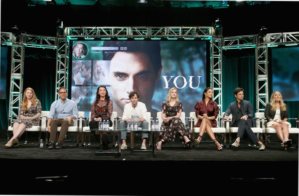 "The Cast and Creatives of ""YOU"" at The 2018 Summer Television Critics Association Press Tour [stage,musical,performance,performing arts,heater,musical theatre,event,performance art,theatre,music venue,you,cast,l-r,summer television critics association press tour,creatives,greg berlanti,sarah schechter,caroline kepnes,actors,penn badgley]"