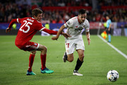 Pablo Sarabia of Sevilla attempts to get past Thomas Mueller of Bayern Muenchen during the UEFA Champions League Quarter Final Leg One match between Sevilla FC and Bayern Muenchen at Estadio Ramon Sanchez Pizjuan on April 3, 2018 in Seville, Spain.