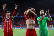 Thomas Mueller of Bayern Muenchen and Sven Ulreich of Bayern Muenchen show appreciation to the fans after the UEFA Champions League Quarter Final Leg One match between Sevilla FC and Bayern Muenchen at Estadio Ramon Sanchez Pizjuan on April 3, 2018 in Seville, Spain.