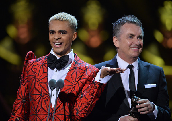 The Olivier Awards 2019 With Mastercard - Show [formal wear,event,fashion,suit,outerwear,smile,performance,ceremony,gesture,tuxedo,layton williams,shane richie,olivier awards,award,stage,england,london,l,mastercard - show,the olivier awards]