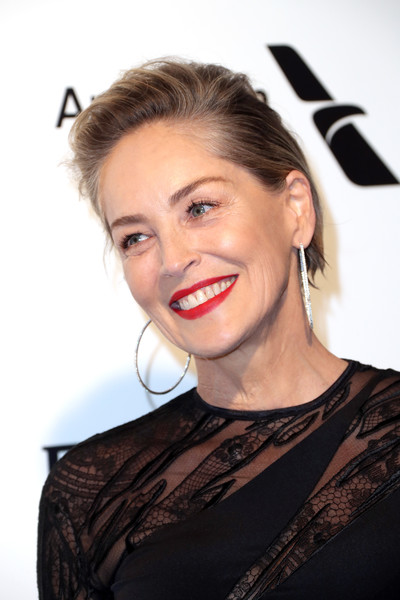 25th Annual Elton John AIDS Foundation's Oscar Viewing Party - Arrivals [image,hair,eyebrow,beauty,human hair color,hairstyle,fashion model,smile,chin,lip,cheek,arrivals,sharon stone,actor,hair,eyebrow,west hollywood park,elton john aids foundation,oscar viewing party,academy awards viewing party,sharon stone,75th golden globe awards,basic instinct,hollywood,photography,celebrity,actor,image,golden globe award]