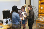 Charlie Day (R) draws a name for a tattoo winner at Shinola, Scott Campbell and Nathan Kostechko Mother's Day Celebration on May 12, 2018 in Los Angeles, California.