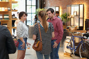 Mary Elizabeth Ellis (L) speak with guests at Shinola, Scott Campbell and Nathan Kostechko Mother's Day Celebration on May 12, 2018 in Los Angeles, California.