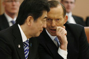 Japanese Prime Minister Shinzo Abe and Australian Prime Minister Tony Abbott talk during a meeting with members of Abbott's cabinet on national security at Parliament House on July 8, 2014 in Canberra, Australia. Prime Minister is in Australia for three days and will sign a Economic Partnership Agreement with Australia. Japan is Australia's second biggest trading partner.