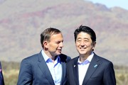 Prime Minister Tony Abbott and the Prime Minister of Japan Shinzo Abe arrive for a tour of the Rio Tinto West Angelas iron ore mine on July 9, 2014 in the Pilbara, West Australia. The Japanese Prime Minister is in Australia for three days and will sign a Economic Partnership Agreement with Australia. Japan is Australia's second biggest trading partner.