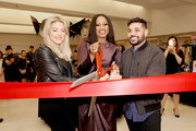 """Co-Hosts Katheryn Winnick, Garcelle Beauvais, and Michael Costello cut the opening ribbon during """"Shop for Success"""": Dress for Success West Coast (LA) fundraiser on November 29, 2018 in Los Angeles, California."""