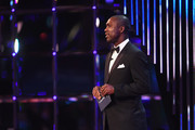 Clarence Seedorf speaks on stage to announce the  Laureus World Sportsperson of the Year with a Disability Award winner during the 2017 Laureus World Sports Awards at the Salle des Etoiles,Sporting Monte Carlo on February 14, 2017 in Monaco, Monaco.