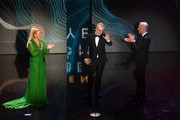 Legend Award-winner Herbert Groenemeyer (C)  is seen on stage holding his award with Barbara Schoeneberger and Tom Junkersdorf during the GQ Men of the Year Award show at Komische Oper on November 8, 2018 in Berlin, Germany.