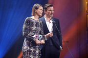 Award winners Jessica Schwarz and Florian David Fitz on stage during the GQ Men of the Year Award show at Komische Oper on November 07, 2019 in Berlin, Germany.