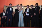 """(L-R) Niels Schneider, Virginie Efira, Adele Exarchopoulos, Justine Triet, Gaspard Ulliel and Paul Hamy depart the screening of """"Sibyl"""" during the 72nd annual Cannes Film Festival on May 24, 2019 in Cannes, France."""
