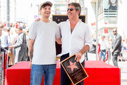 Louis Tomlinson (L) and Simon Cowell attend a ceremony honoring Cowell with a star on the Hollywood Walk of Fame on August 22, 2018 in Hollywood, California.