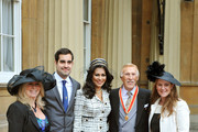 Sir Bruce Forsyth and his wife Wilnelia arrive with his children (L-R) Laura (L) Jonathan (2L) and Laura (R) at Buckingham Palace where he will be knighted by Queen Elizabeth II on October 12, 2011 in London, England. The Strictly Come Dancing host's place as a leading TV presenter is recognised after years of campaigning by fans.